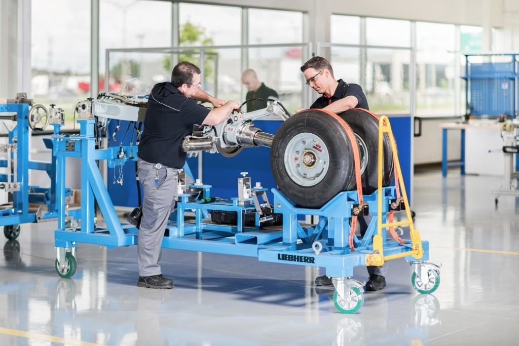 Preparation for transport of a C Series landing gear at Liebherr-Aerospace in Laval.