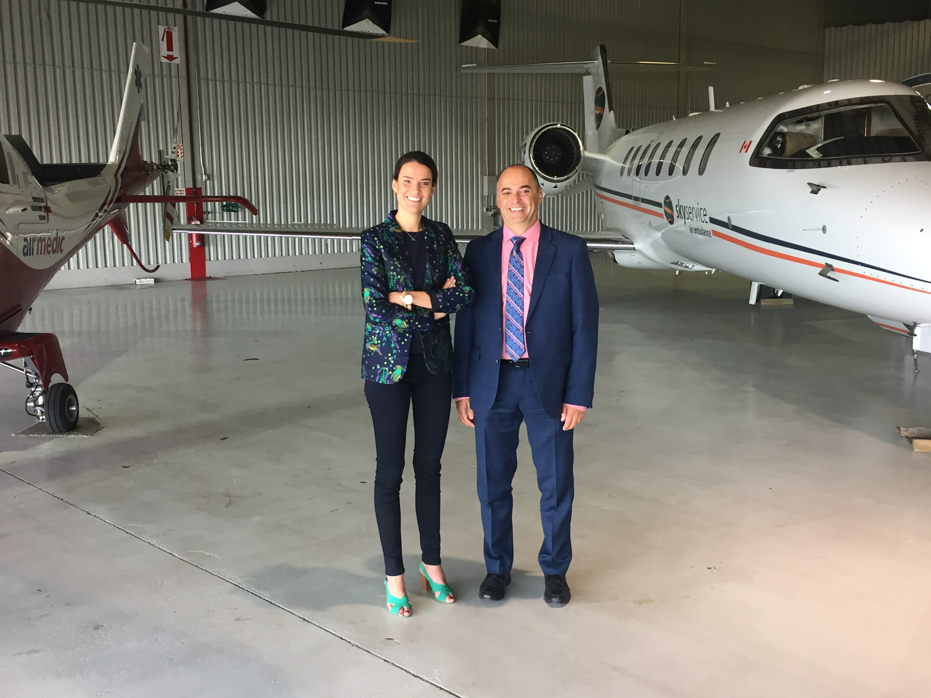 Sophie Larochelle, Airmedic executive vice-president, stands with Sam Cimone, president of Skyservice Air Ambulance International. The two companies have combined resources to offer comprehensive critical care air ambulance service. Airmedic Photo