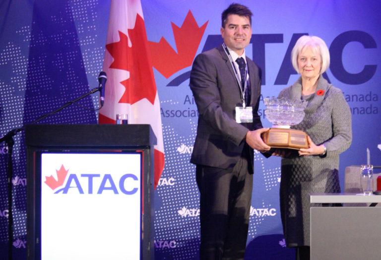 DCAM founder Jane Abramson presents the 2017 DCAM Flight Instructor Safety Award to Luke Penner, chief flight instructor at Harv's Air of Winnipeg, Man.
