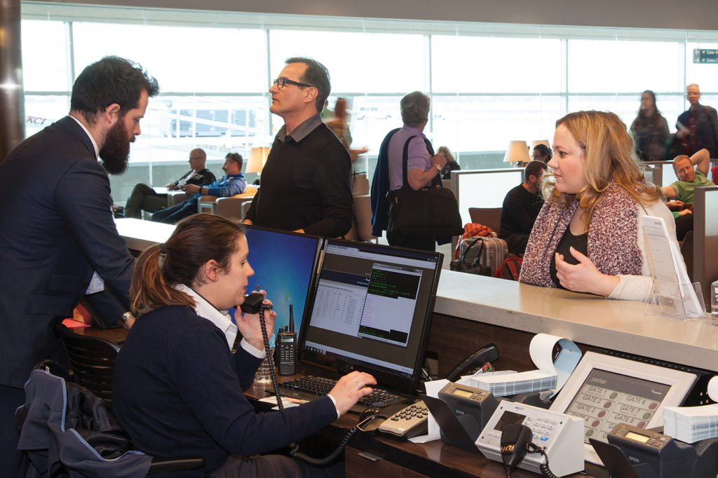 Porter Airlines staff help passengers at Billy Bishop Toronto City Airport.