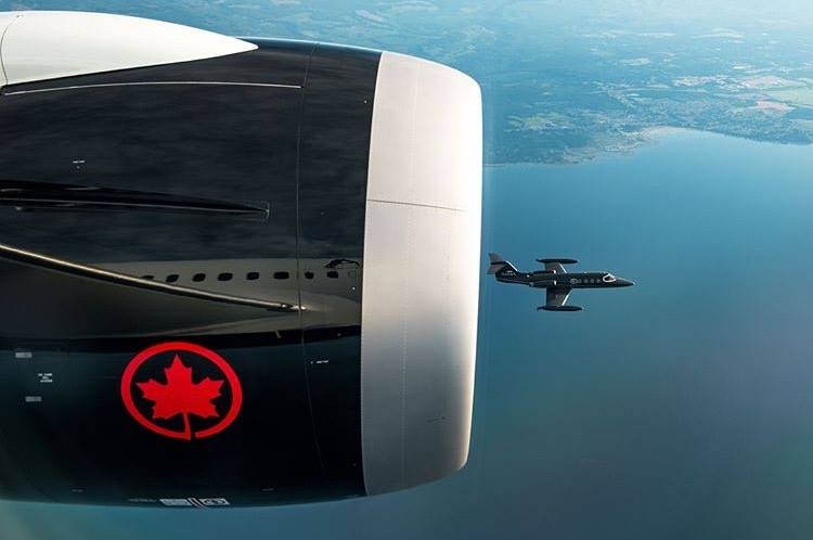 A Learjet 25B flies almost parallel to an Air Canada Boeing 787 giant over Vancouver Island. Photo submitted by Rammy Fong (Instagram user @rammyfong) using #skiesmag
