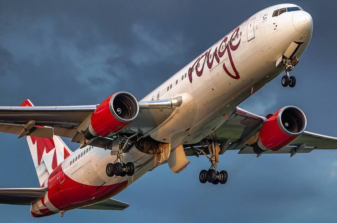 Ground view of an Air Canada Rouge Boeing 767 with eye-catching livery at Toronto Pearson International Airport. Photo submitted by John Chung (Instagram user @jcjchung) using #skiesmag