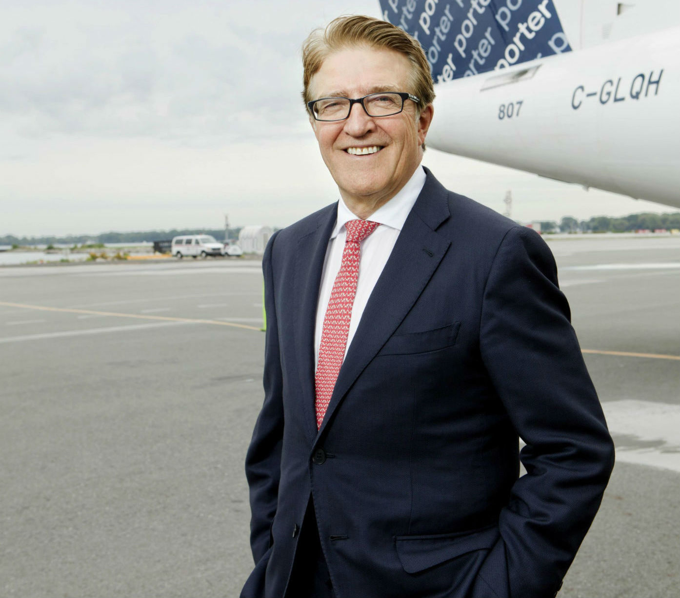Porter Airlines president and CEO Robert Deluce stands with a Porter aircraft.