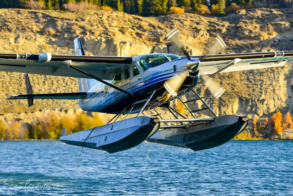 Black Sheep Aviation Cessna 208 Supervan 900 with a Texas Turbines engine conversion taking off from Schwatka Lake, Yukon. Photo submitted by Simon Blakesley