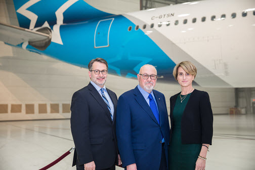 From left to right: Jean-Francois Lemay, president of Air Transat, Jean-Marc Eustache, president and chief executive officer of Transat, and Annick Guérard, chief operating officer of Transat stand infront of the iconic Air Transat star symbol. Transat A.T. Photo