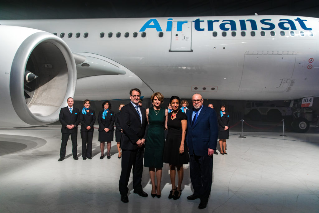 From left to right : Jean-François Lemay, president of Air Transat; Annick Guérard, chief operating officer of Transat; Dominique Anglade, Quebec deputy premier, minister of economy, science and innovation, and minister responsible for the digital strategy; and Jean-Marc Eustache, president and chief executive officer of Transat stand in front of the company's A330 aircraft with Air Transat flight crew behind. Transat A.T. Photo