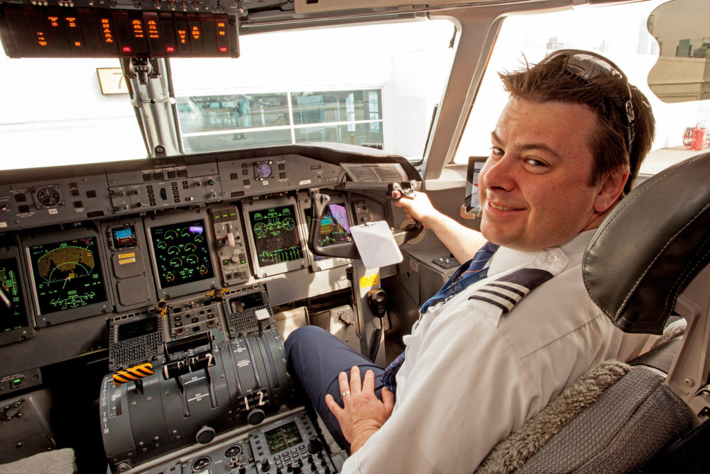 A pilot from Porter Airlines sits in the cockpit of a Bombardier Q400 at Billy Bishop Airport in Toronto, Ont. Andy Cline Photo