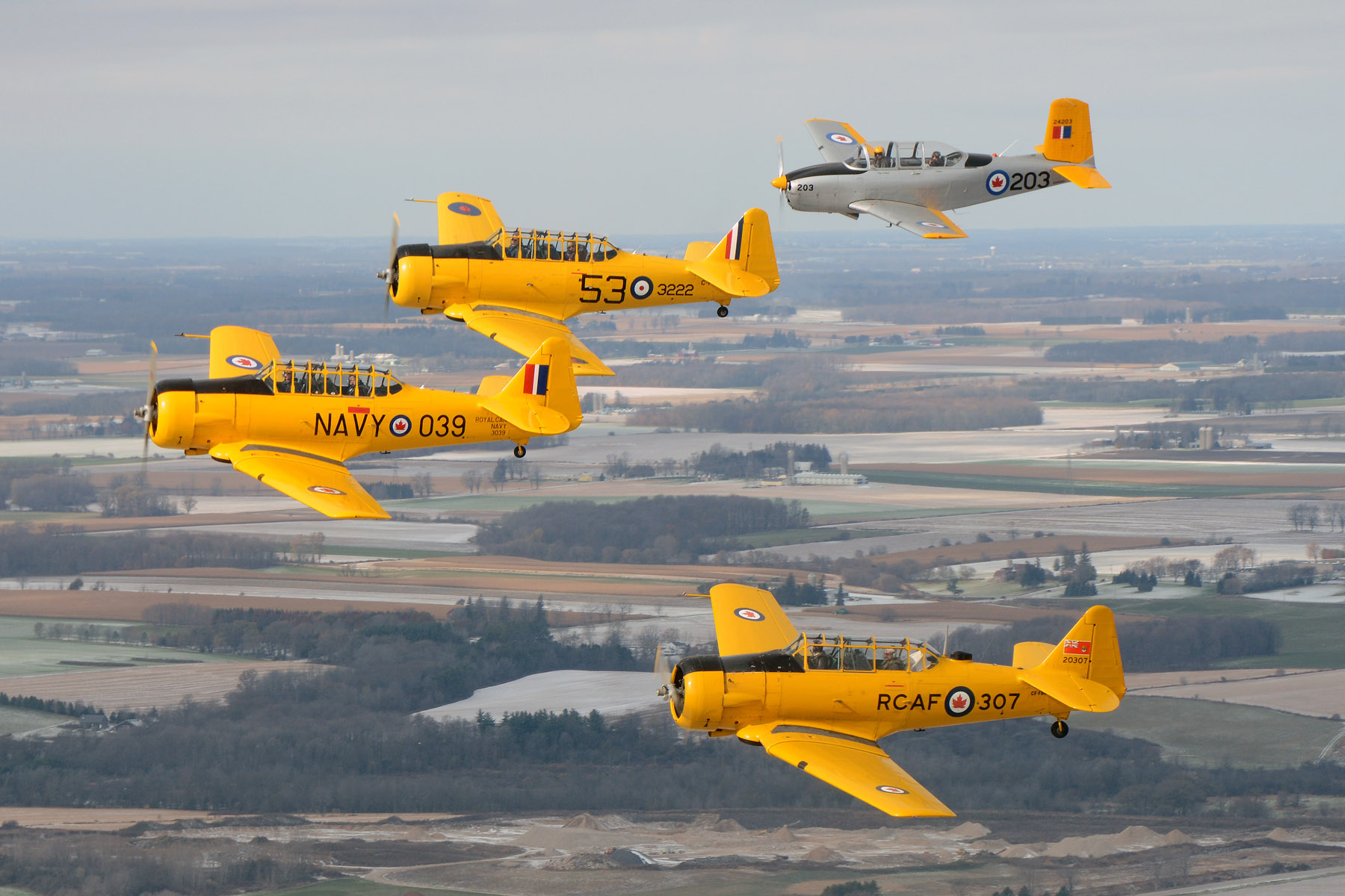 The Canadian Harvard Aerobatic Team flies over Woodstock, Ont.