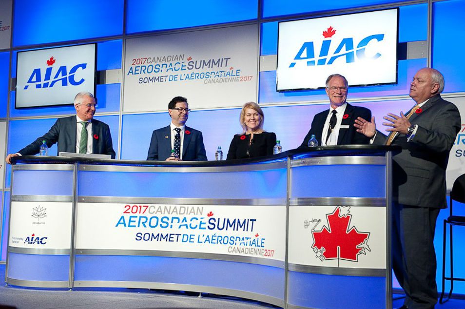 A panel of industry executives speaks at the 2018 Canadian Aerospace Summit.