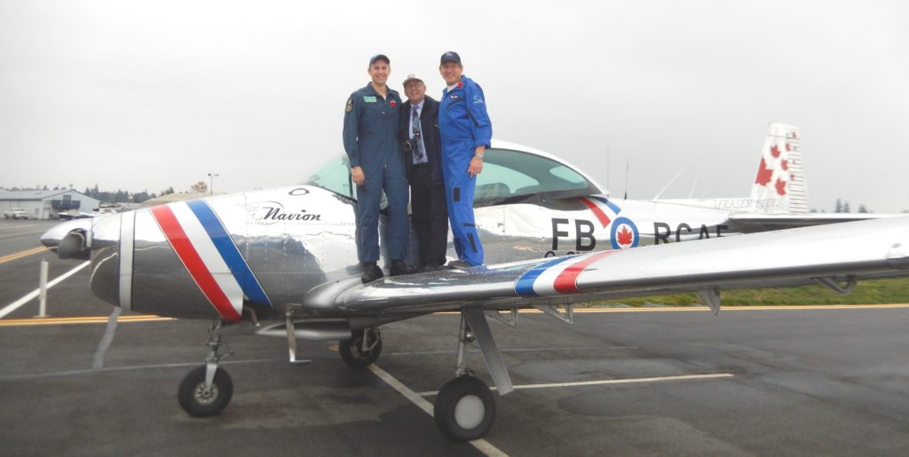 At left, Tristan Dyke, author John Chalmers at centre, and pilot George Miller who led the Fraser Blues in their annual Remembrance Day flypasts. John Chalmers Photo