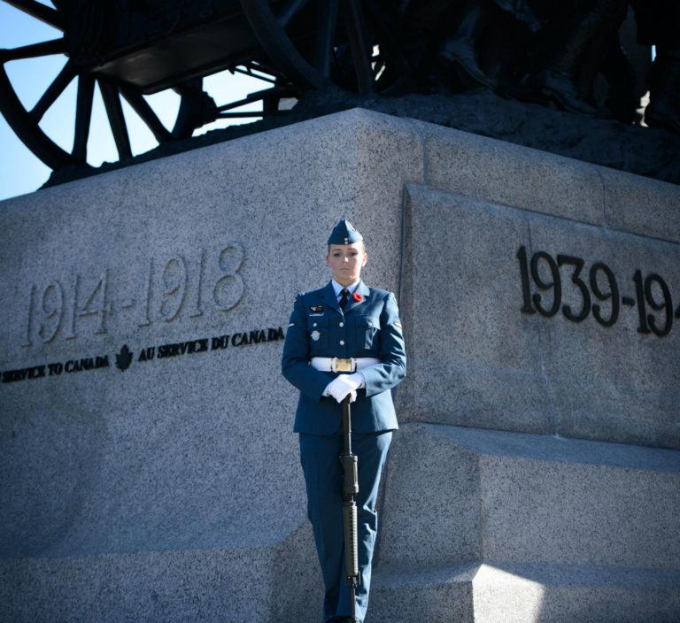 Aviator Sarah Comeau stands at National War Memorial