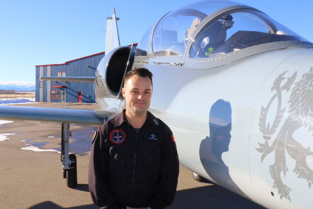 Gary Patrick stands with jet trainer