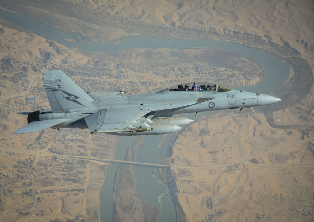 A Royal Australian Air Force F/A-18F Super Hornet manoeuvres over Rawah, Iraq.