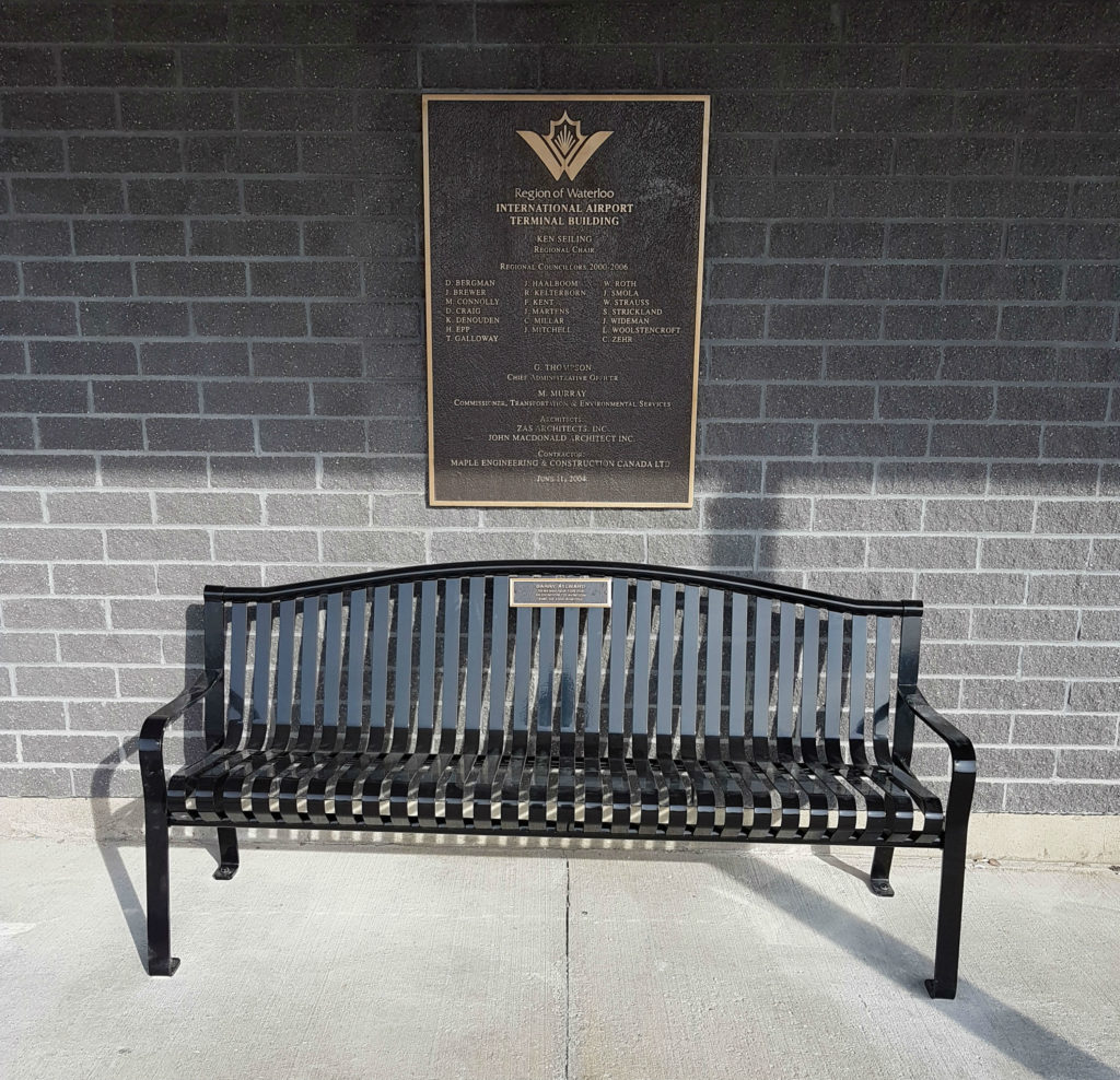 The memorial bench that pays tribute to Barry Aylward was installed in front of the terminal at the Region of Waterloo International Airport. Kitchener Aero Photo
