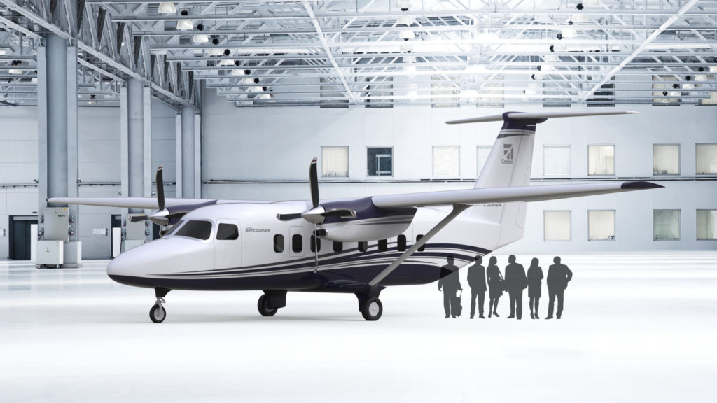 SkyCourier in hangar, with silhouettes of people standing around