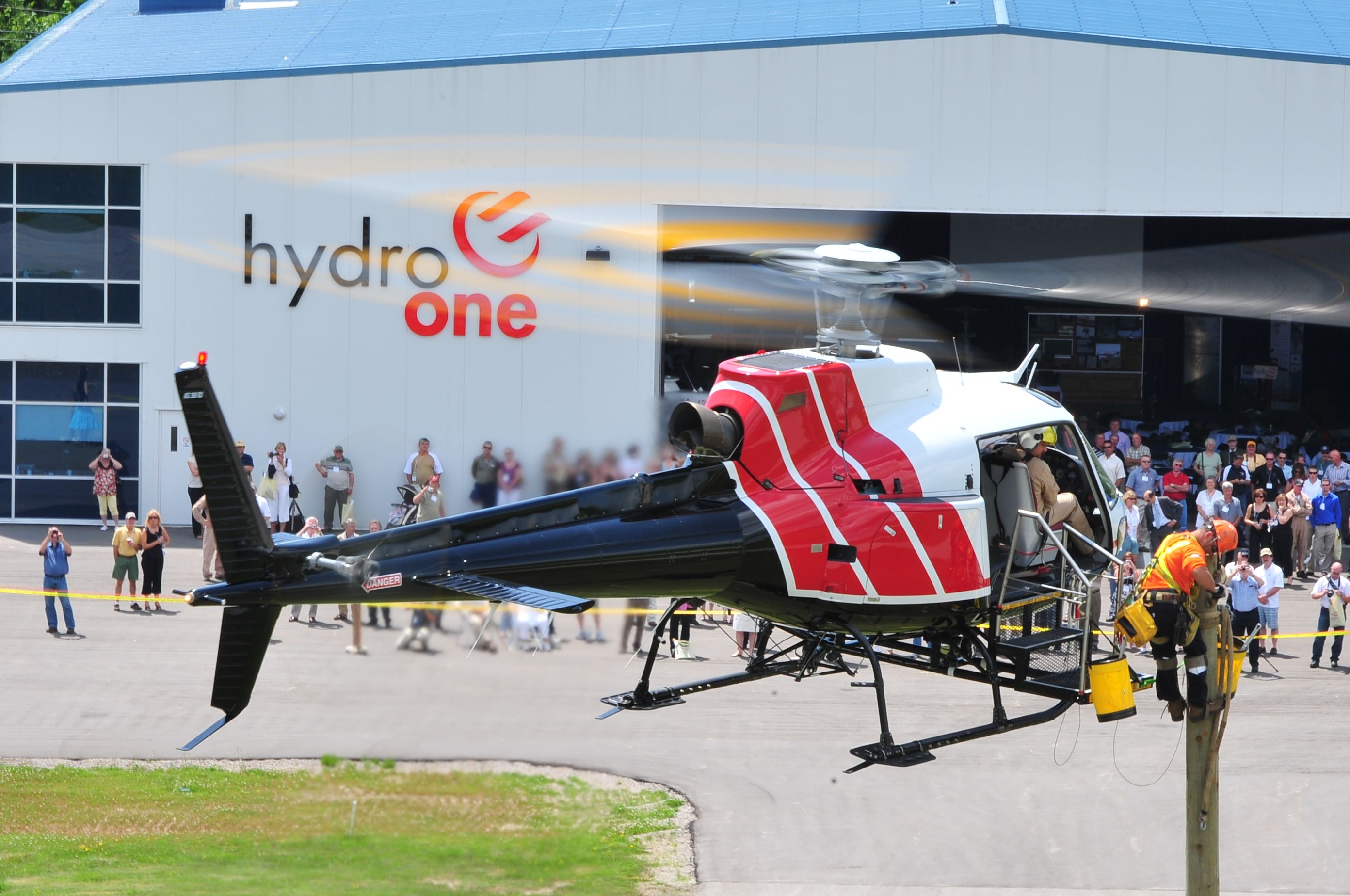 A Hydro One crew demonstrates the use of an external AirStairs platform.