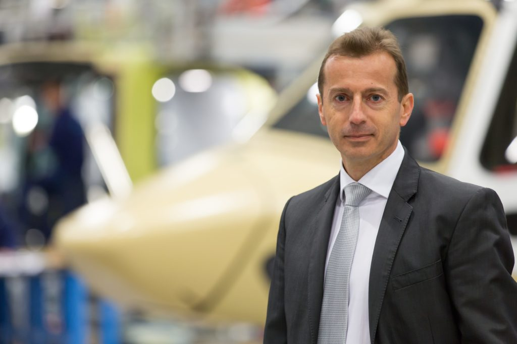 Faury stands in front of Airbus helicopter airframe.