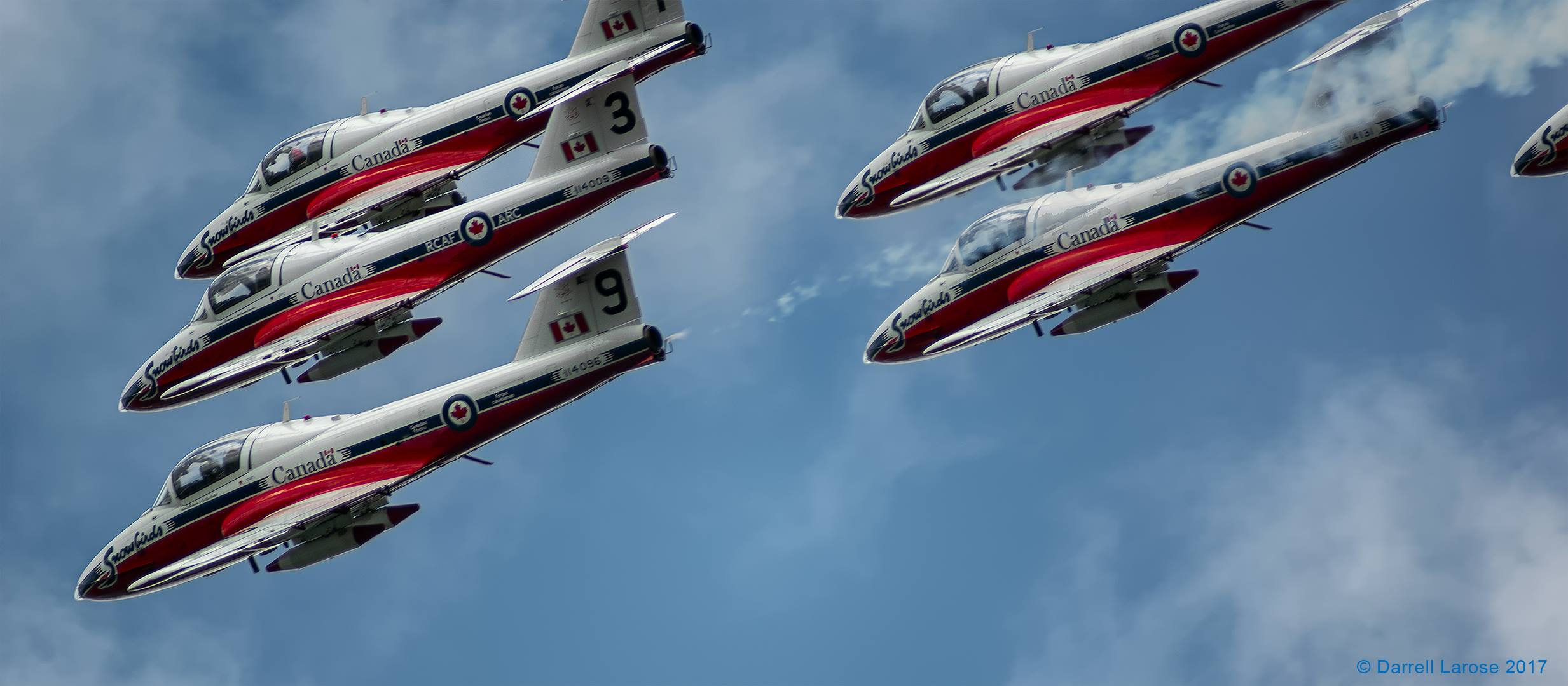 The Canadian Forces Snowbirds pass over Parliament Hill in Ottawa in July, 2017.
