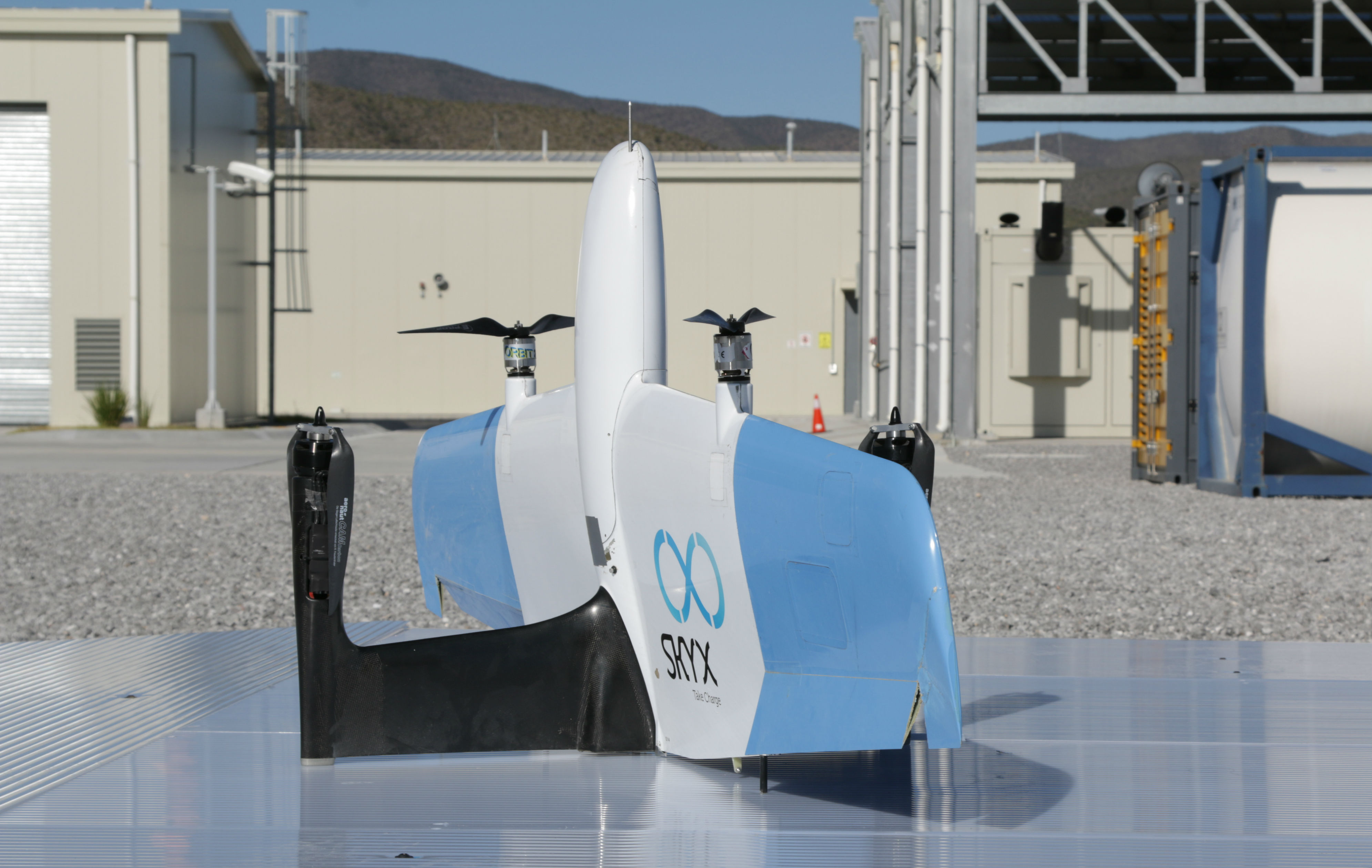 SkyOne drone rests on silver-coloured pad.