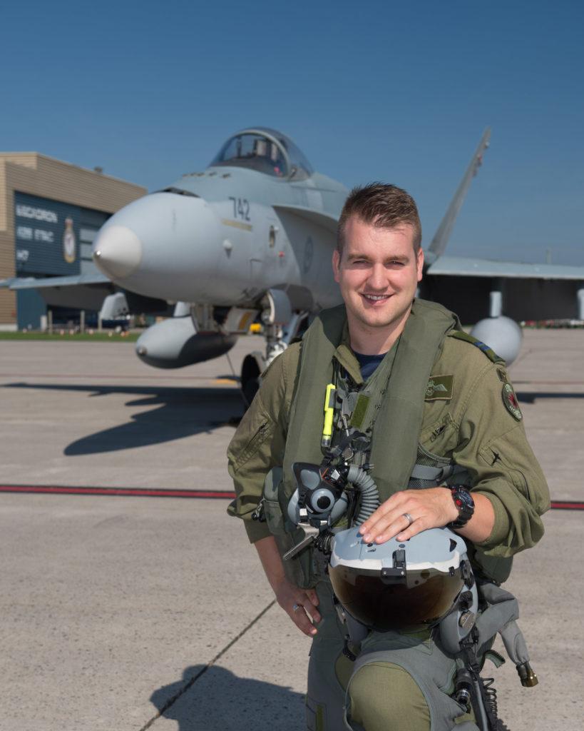 Capt Stefan Porteous poses with a CF-188 Hornet.