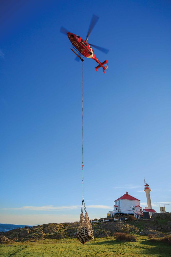 Coast Guard helicopter dangles a long line
