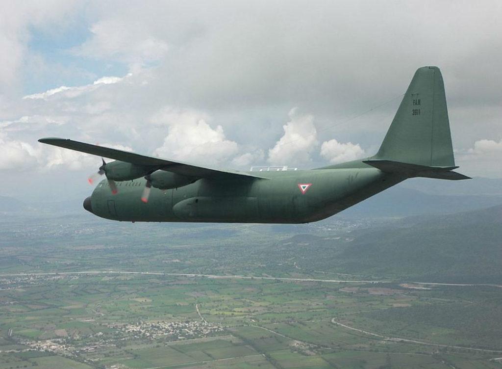 A Fuerza Aérea Mexicana L-100 (C-130) Hercules aircraft, in flight.