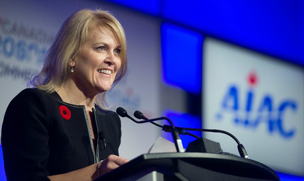 Cynthia Garneau stands at podium