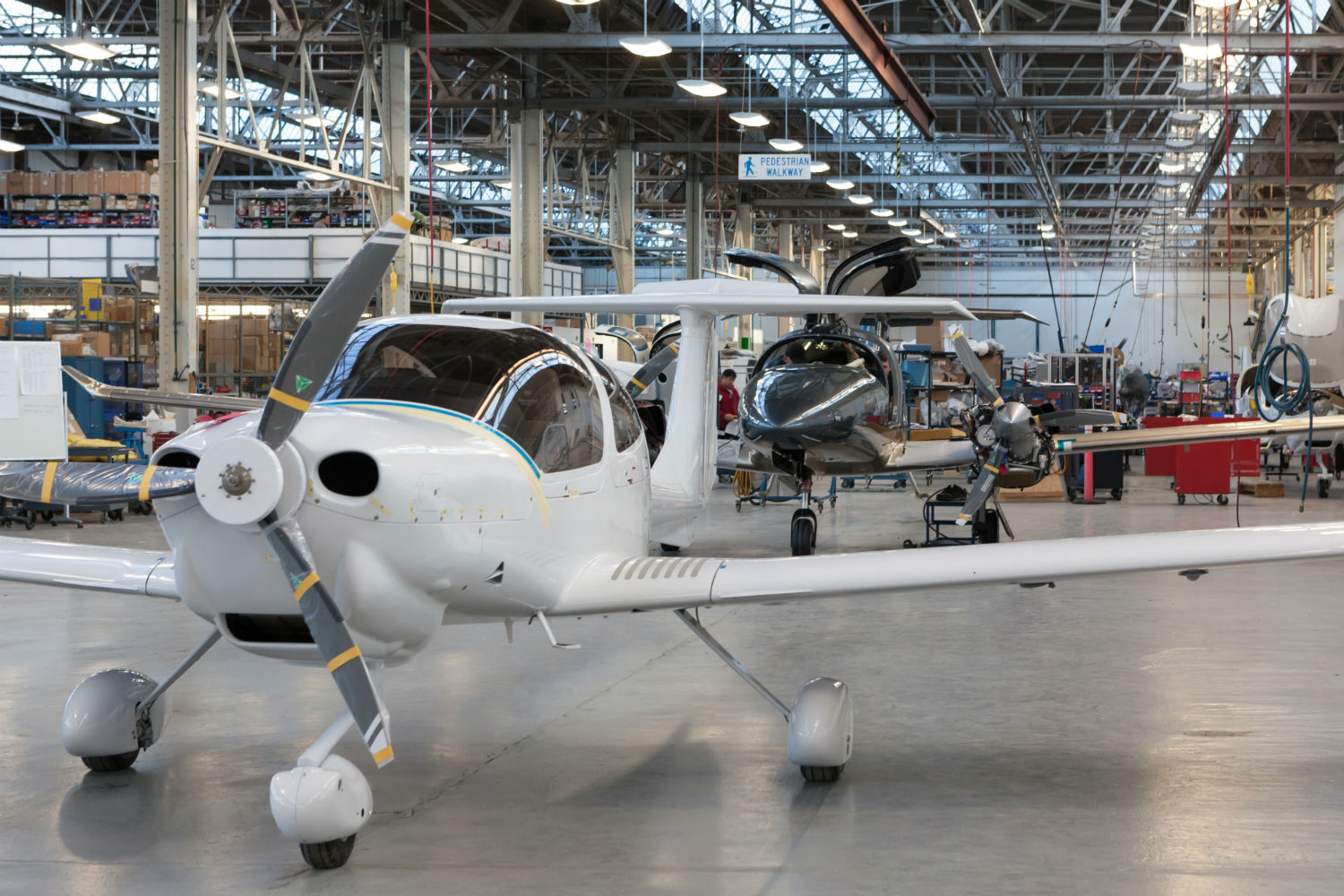 A Diamond DA40 (foreground) and DA62 rest on the production line in London, Ont.
