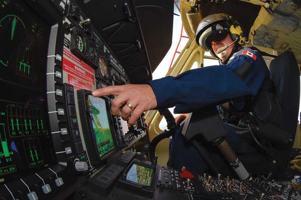 Man inside helicopter cockpit.