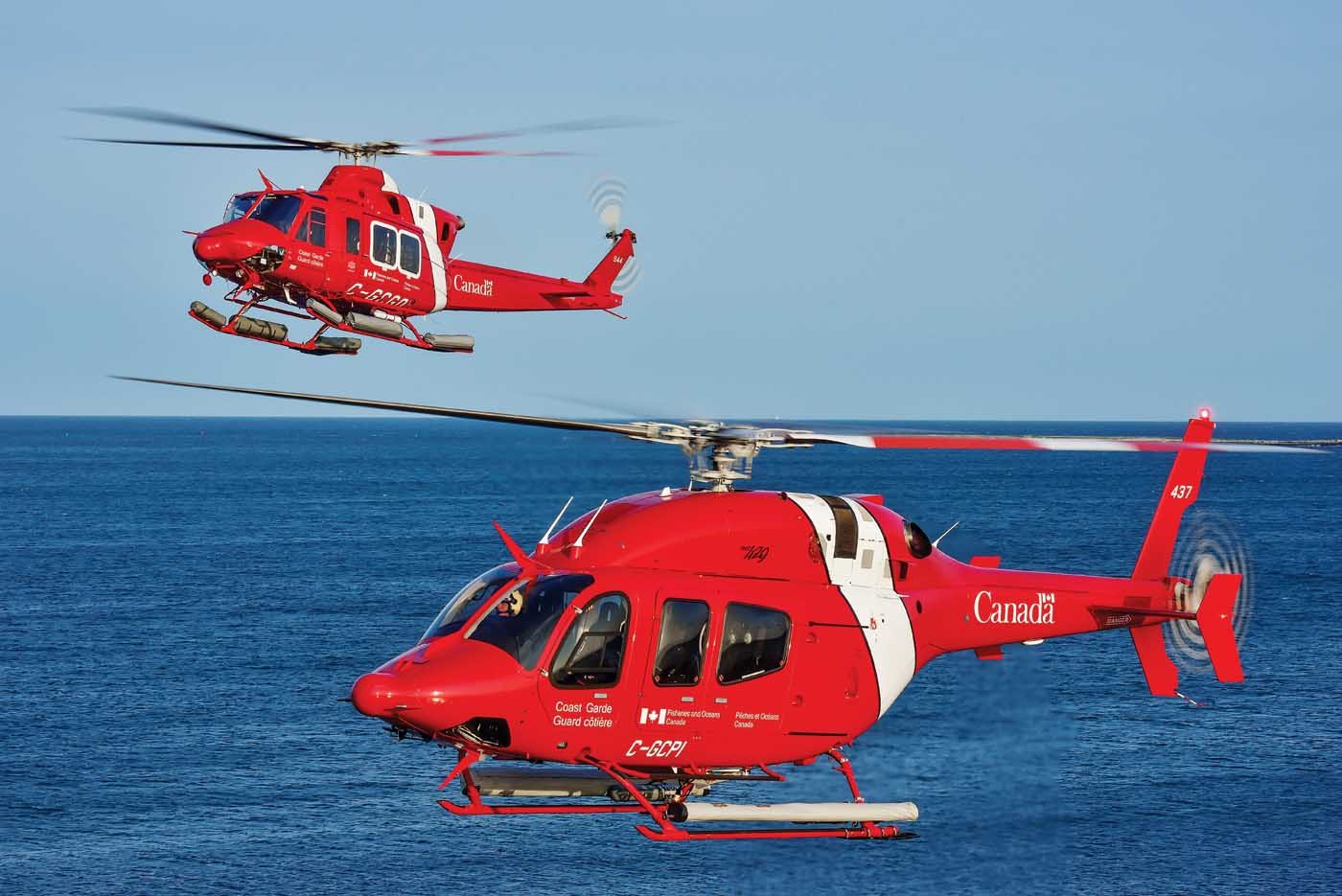 Two coast guard helicopters in flight