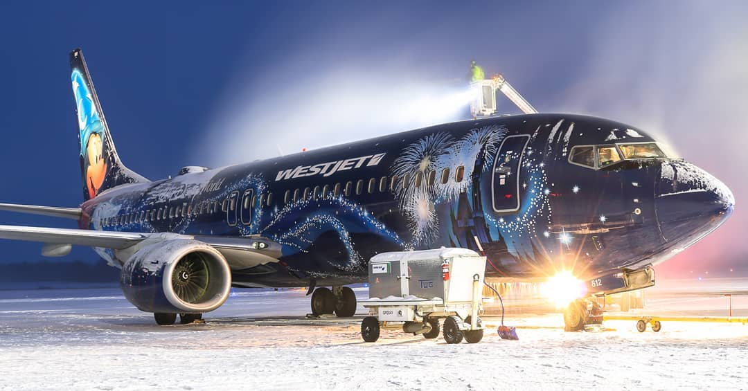 A Disney-themed WestJet Boeing 737 getting sprayed in London, Ont., before heading back to Calgary. Photo submitted by Garret Rodgers