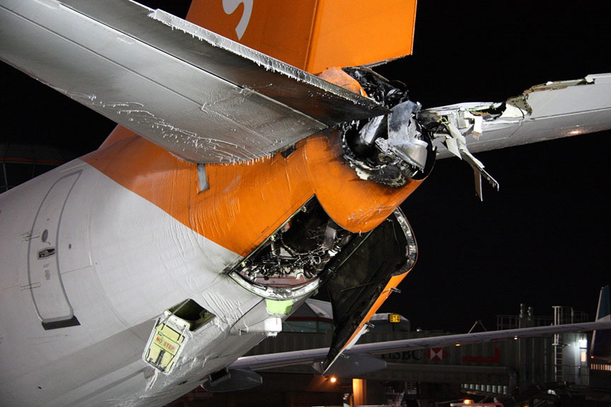 View of tail section of Sunwing aircraft