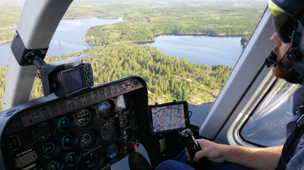 Inside cockpit of flying helicopter