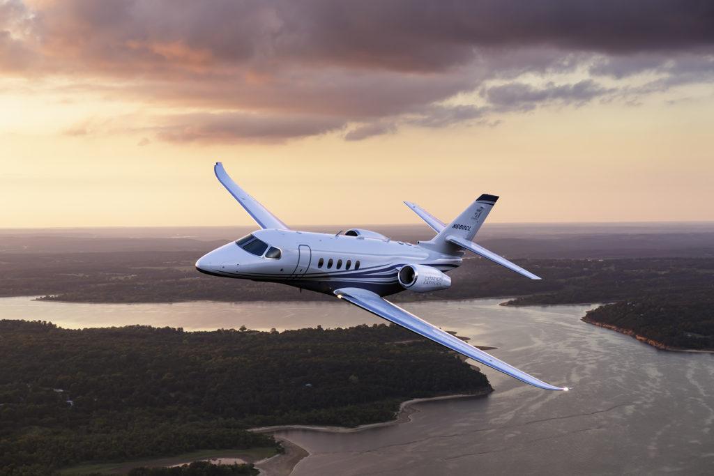 Aerial photo of the Textron Cessna Latitude business jet flying over Keystone Lake, west of Tulsa, Okla.