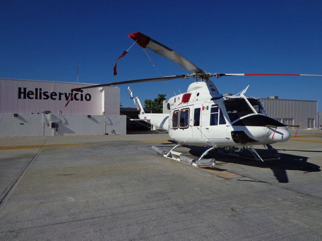 Heliservicio Bell 412 rests on ground
