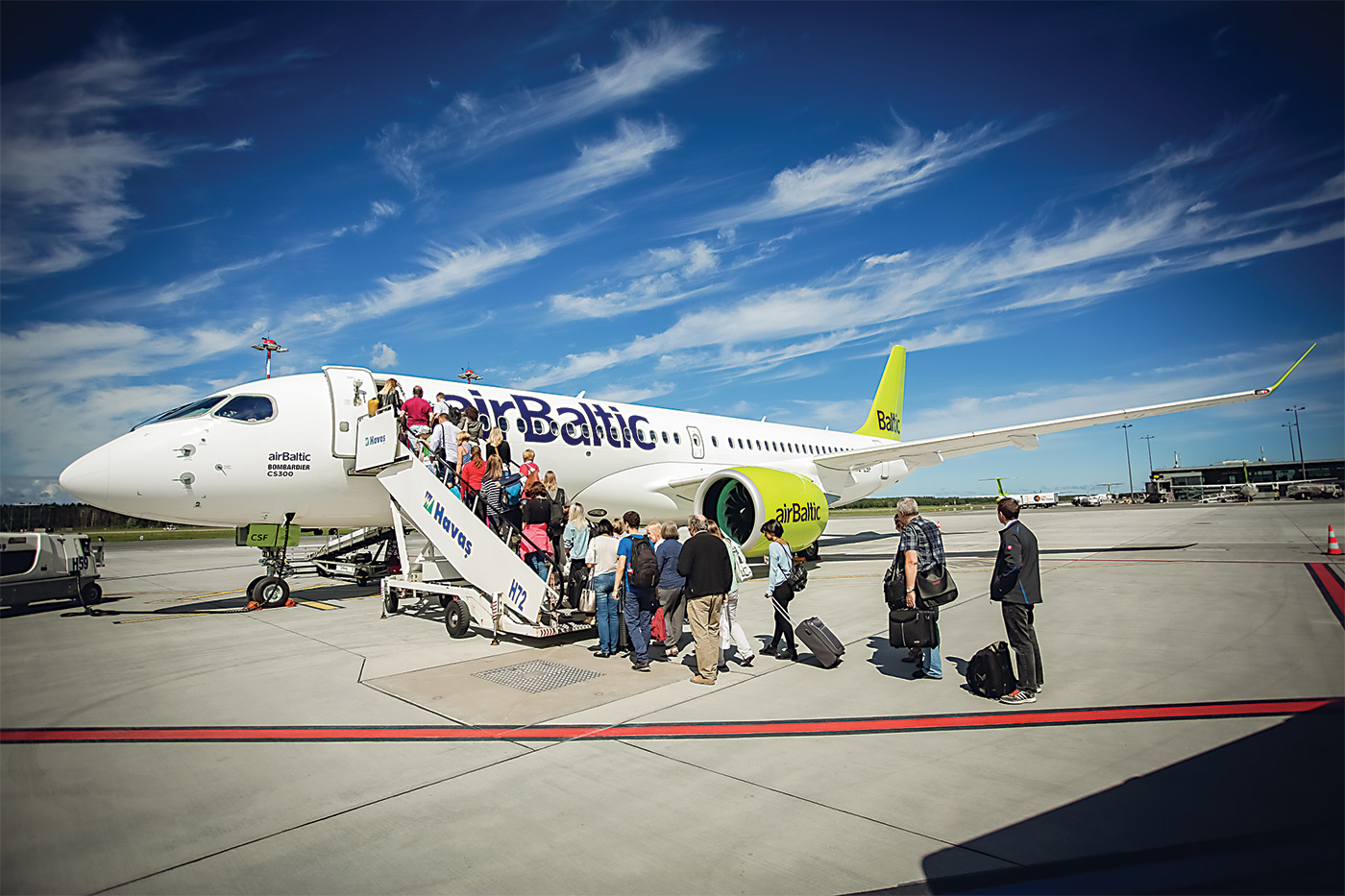 airBaltic CS300 rests on ground