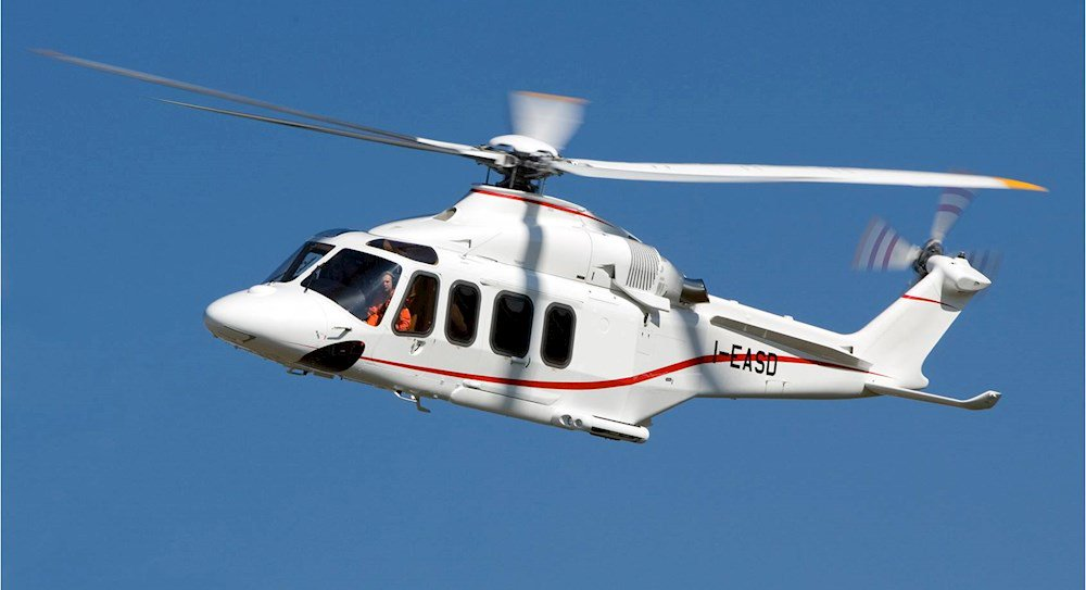 White and red AW139 in flight
