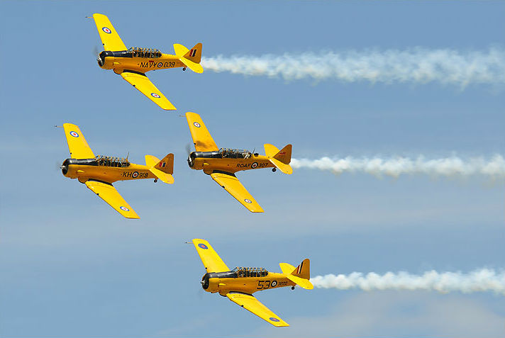 The Canadian Harvard Aerobatic Team was formed in 2000 as a three-ship routine and became the four-ship routine that it is today in 2014 when Harvard pilot Marco Rusconi joined the team. Each performance is finished with a topside photo pass. Eric Dumigan Photo