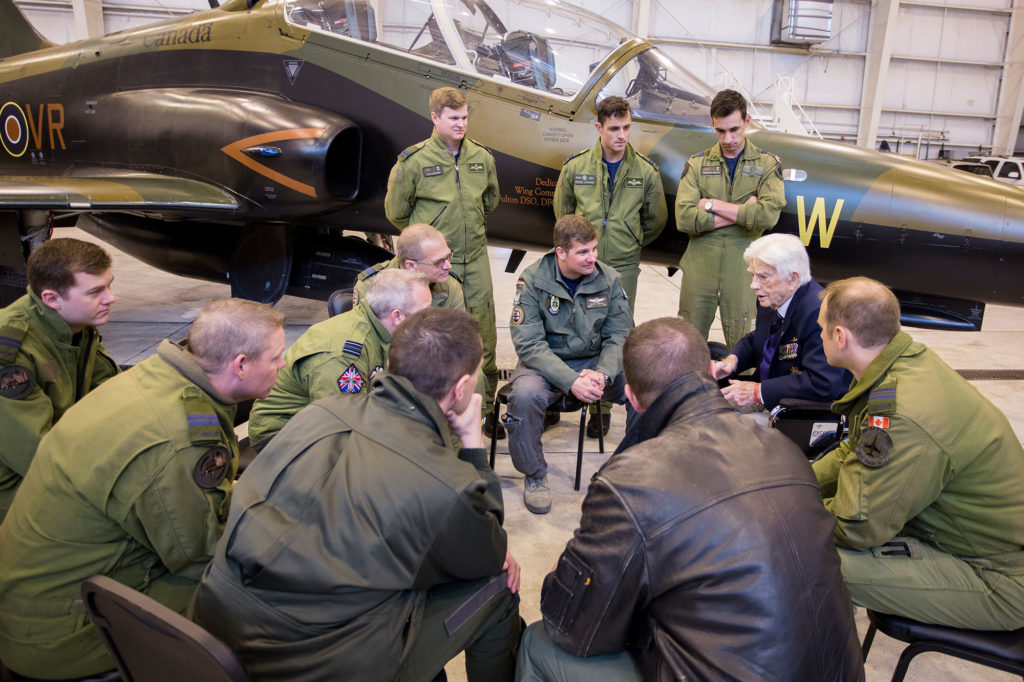 Members of 419 Tactical Fighter (Training) Squadron sit with Sweanor following the unit's training mission in El Centro, Calif.