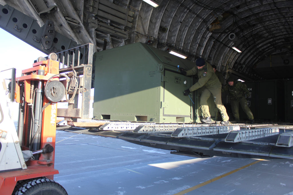 Traffic techs prepare to unload 409 Tactical Fighter Squadron gear from a CC-177 Globemaster.