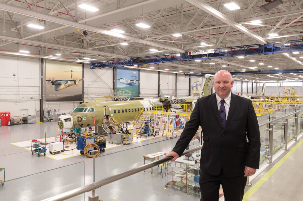 Todd Young, vice-president and general manager of customer services for Bombardier Commercial Aircraft, stands in front of the Q400 assembly line in Downsview