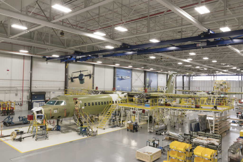 Factory floor photo with aircraft being assembled