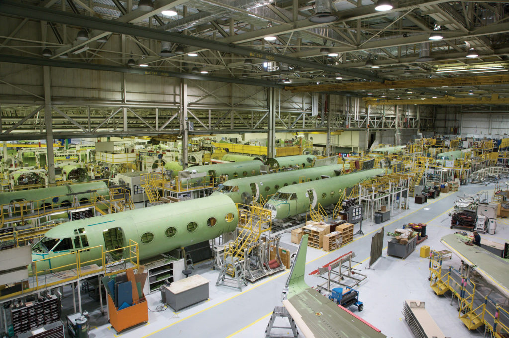 Wide-angle shot of factory floor where aircraft are being assembled