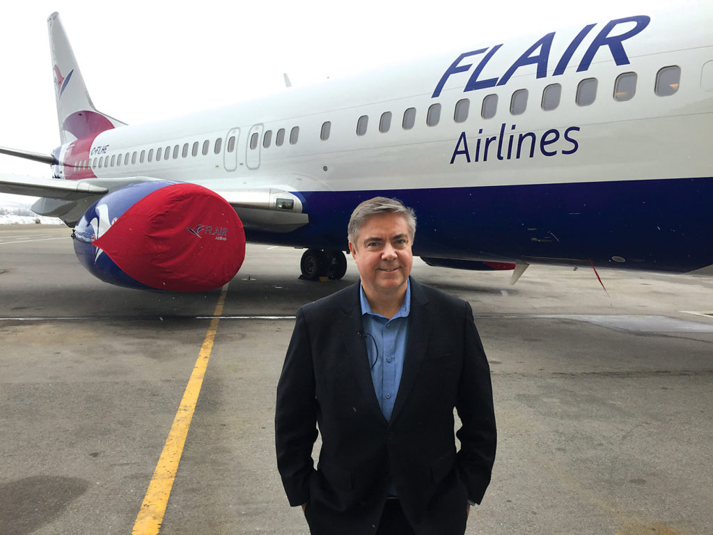 Jim Scott stands in front of Flair airliner