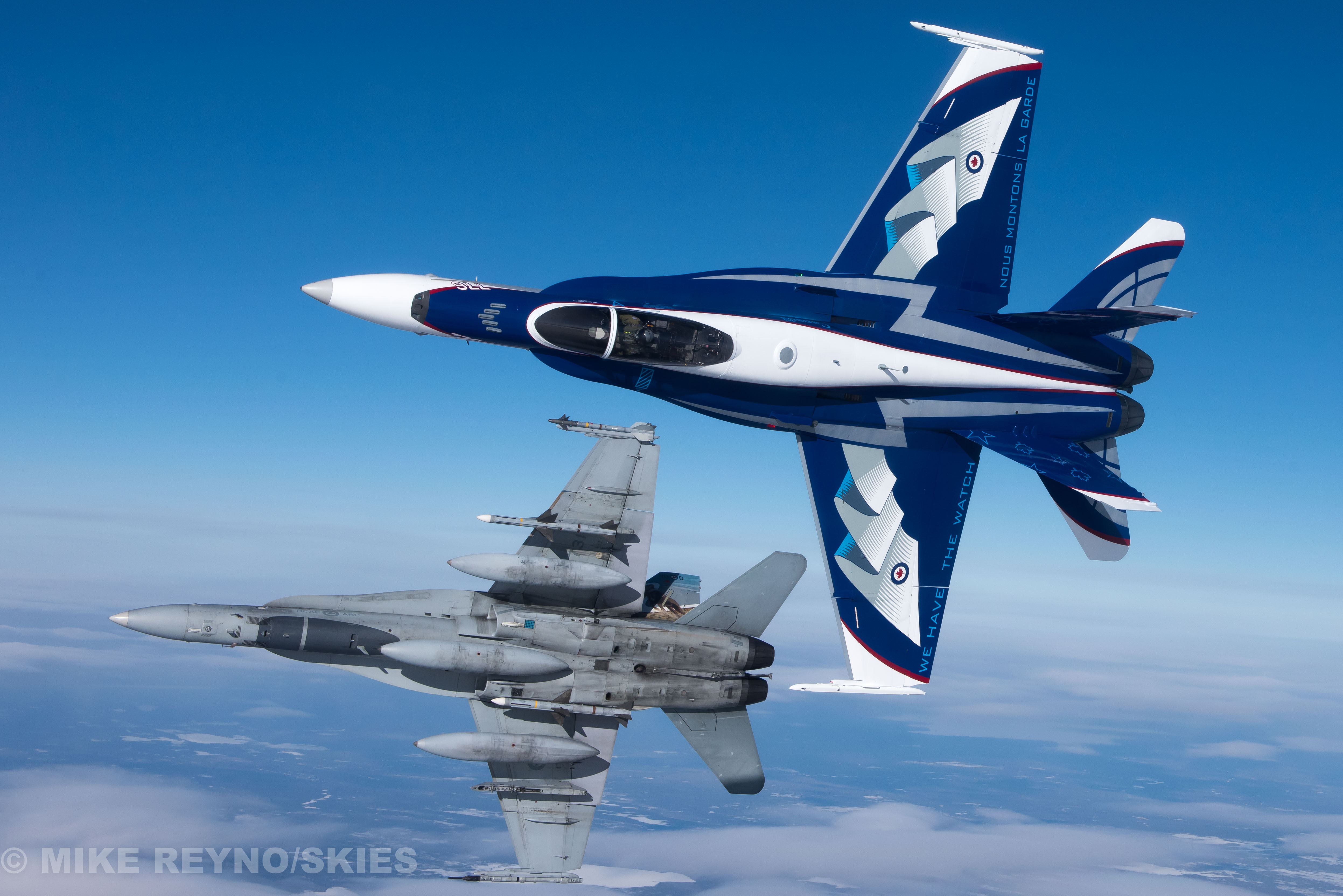 The 2017 Demonstration Hornet (foreground) flies with a CF-188 Hornet from 401 Squadron. The Demo Hornet pays tribute to the 60th anniversary of NORAD.