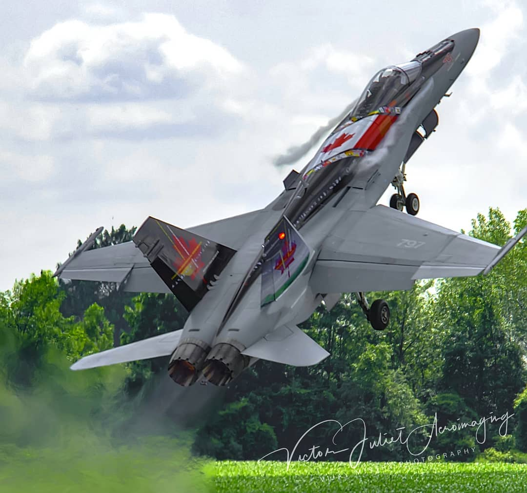 The 2013 CF-18 Demo Hornet, taking off like a rocket. Photo submitted by Vijay Mistry (Instagram user @victor_juliet_aeroimaging) using #skiesmag