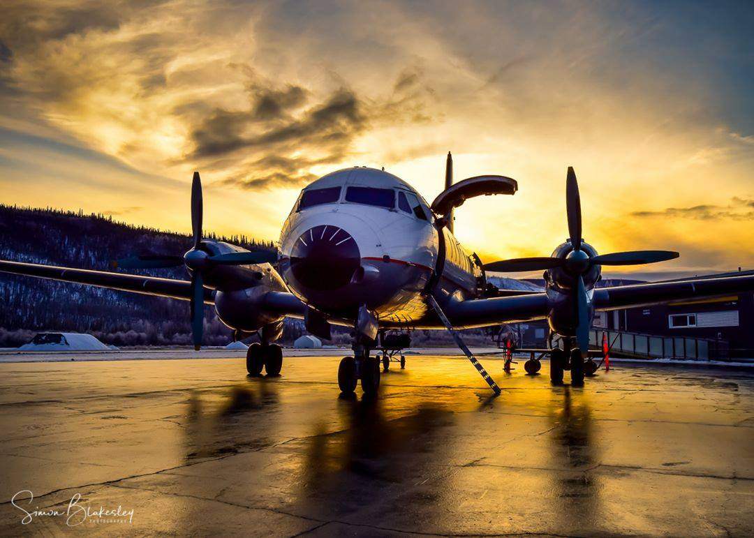 An Air North Hawker-Siddeley HS 748 awaits a sunset departure at Dawson City Airport in Yukon. Photo submitted by Simon Blakesley (Instagram user @simon_blakesley) using #skiesmag