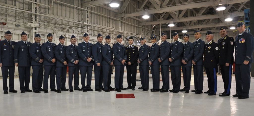 RCAF officers and officers of other air forces associated with the NATO Flying Training in Canada Program at 2 Canadian Forces Flying Training School, gather with the most recent graduates of the program. DND Photo