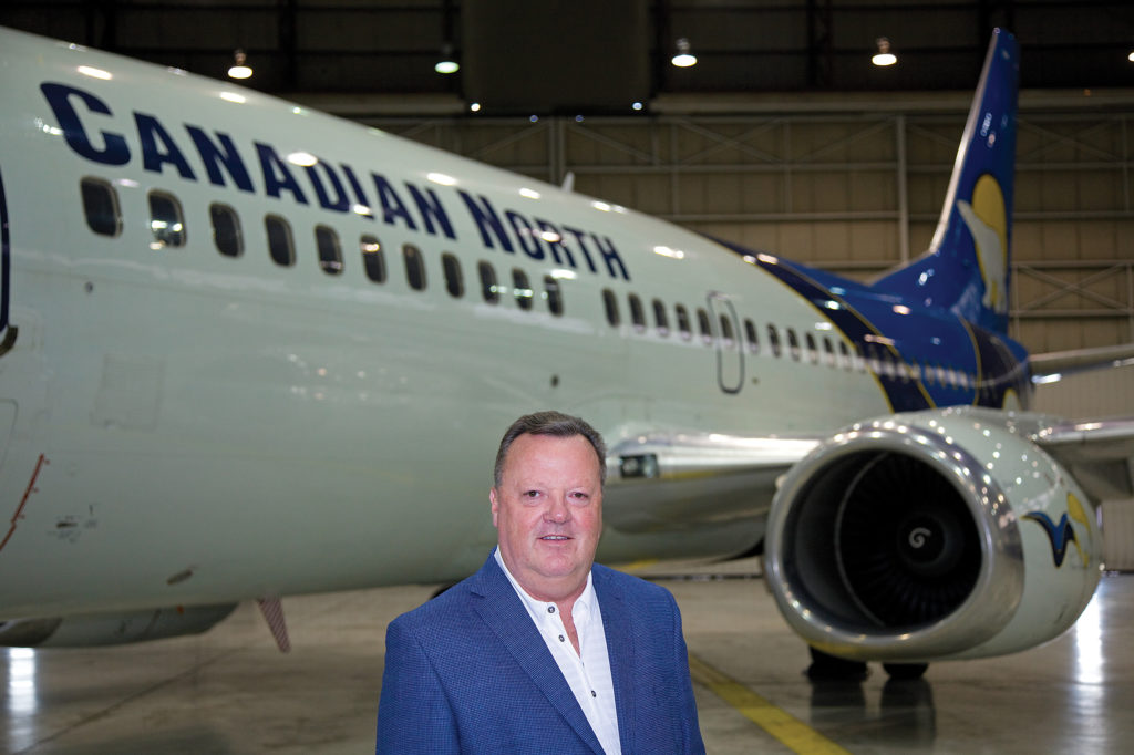 Hankirk stands in front of Canadian North airliner