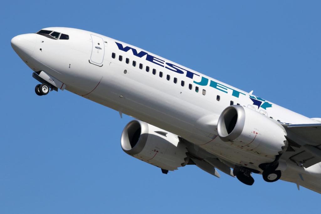 WestJet airliner in flight